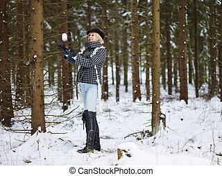 Fashionable woman and winter clothes - rural scene -...