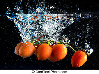 tomatoes splash - a bunch of tomatoes falling into water