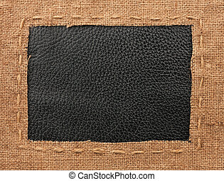 Frame of burlap, lies on a background of leather, with place...
