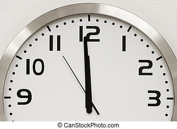 Wall Clock - A modern wall clock showing five seconds until...