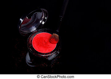 Eyeshadow With Brush and Loose Powder on Black Background