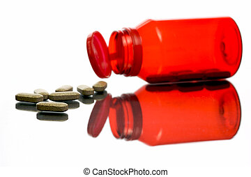 Vitamins - Vitamin tablets in containers isolated and...