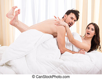 Sex - Young love couple in bed, romantic scene in bedroom