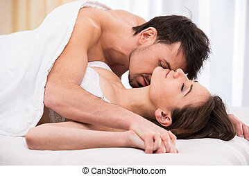 Sex - Young love couple in bed, romantic scene in bedroom.