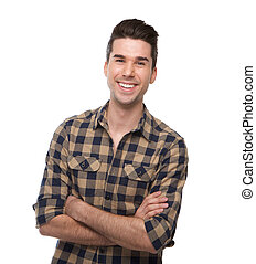 Smiling young man posing with arms crossed
