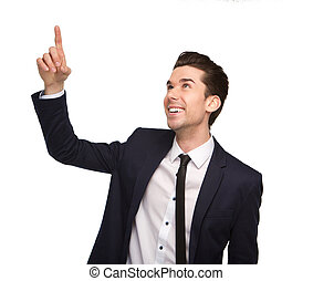 Smiling young business man pointing finger