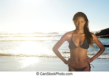 Sexy african american woman in bikini at the beach -...