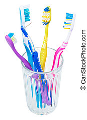 four tooth brushes and interdental brush in glass - family...