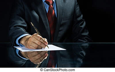 Signing a deal! - Close up of businessman sitting at table...