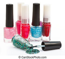 set of nail polish bottles and spilled lacquer