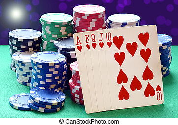 Poker chips pile and royal flush combination of cards on...