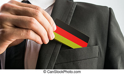 Wooden card painted as the German flag - Man withdrawing a...