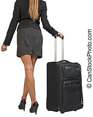 Cropped image of businesswoman with wheeled travel bag makes...