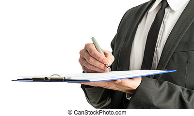 Side view of a businessman signing legal papers on a map...