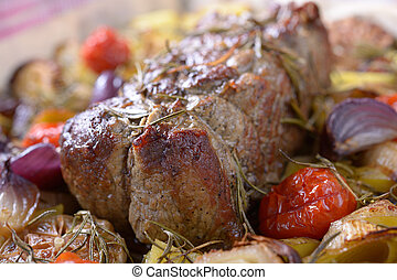 Roast beef with baked vegetables. Shallow DOF