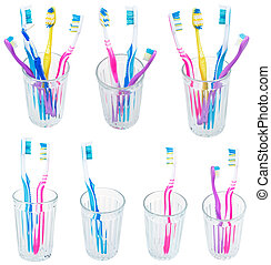 collection of toothbrushes in glases isolated on white...
