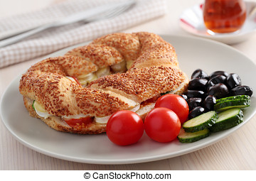 Turkish breakfast with simit, cheese, cherry tomato,...