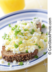 Goldenrod eggs: grated boiled egg on the toast with cheese...