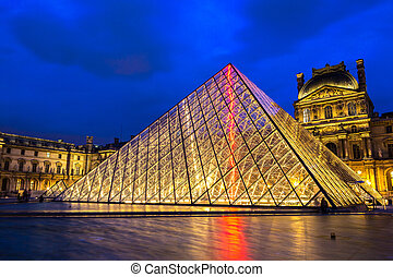 The Louvre at night in Paris - PARIS, FRANCE - JULY 14 2014:...