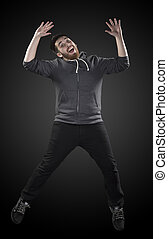Full Length Shot of Young Man in Wacky Pose - Full Length...