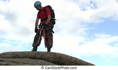 Climber On Mountain Top - Man On The Top Of The Cliff