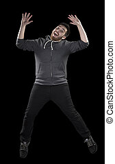 Happy Man in Wacky Pose on Black Background - Full Length...