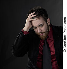 Troubled Man in Black and Maroon Formal Wear