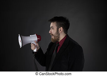 Man in Side View Holding Megaphone