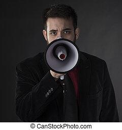 Close up Serious Man Holding Megaphone