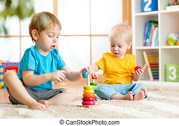 kids boys with toys in playroom - kids boys with educational...
