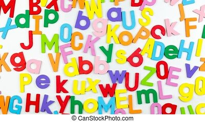 Alphabet magnets on whiteboard - Alphabet magnets...
