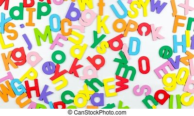 Alphabet magnets on whiteboard - Alphabet magnets being...