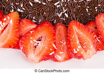 Strawberry cake with chocolate in the closeup as a...