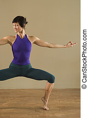 Yoga Stance - Woman in yoga pose with mudra.