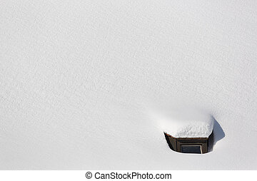Snowbound roof top of church in Bavaria, Germany