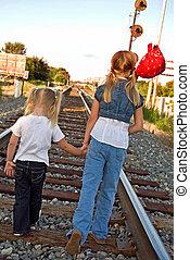 Happy Wanderers - Little girls wandering down the railroad...