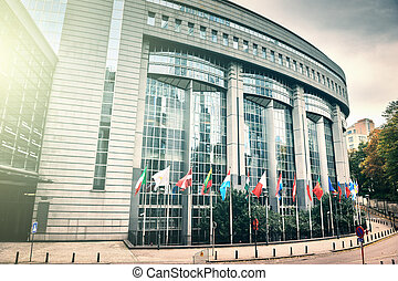 Flags in front of European Parliament building Brussels,...