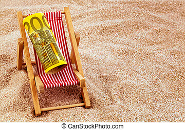beach chair with euro bill - a deck chair with a euro...