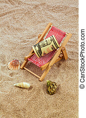 beach chair with piggy bank and dollars - beach chair with...