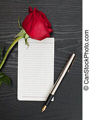 Rose and sheet of paper - Red rose, sheet of paper and...