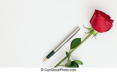 fountain pen and rose - fountain pen and a red rose lying on...