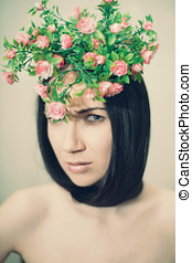 Artficial flowers - portrait of young woman with plastic...