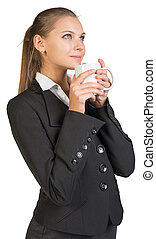 Businesswoman holding mug at her mouth. Isolated over white...
