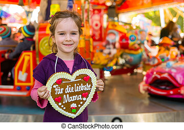 child with gingerbread heart - a little girl hät a heart...