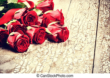 Bouquet of red roses on grunge background