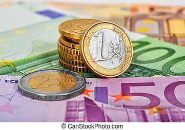 euro coins - many euro coins money and bills, close up