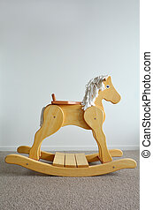 Wooden Rocking Horse. Childhood concept. copyspace