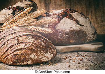 Selection of freshly baked bread in rustic setting