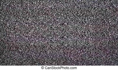TV snow with large noise. - Real television static with...