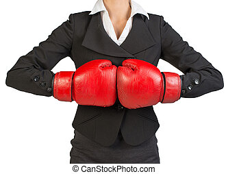 Cropped image of businesswoman in boxing gloves holding fist...